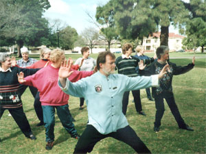 Allan teaching a Tai Chi class in the park