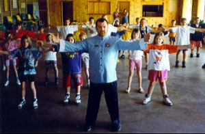 Allan leads a group of students through Chi Kung exercises
