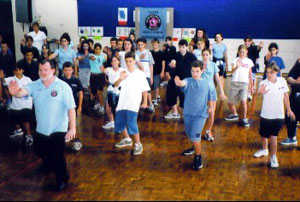 Allan leading students in Tai Chi exercises